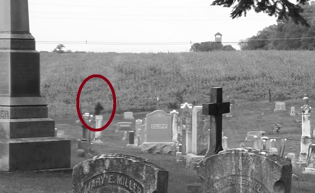 Black_mass_cemetery_circled_zoom